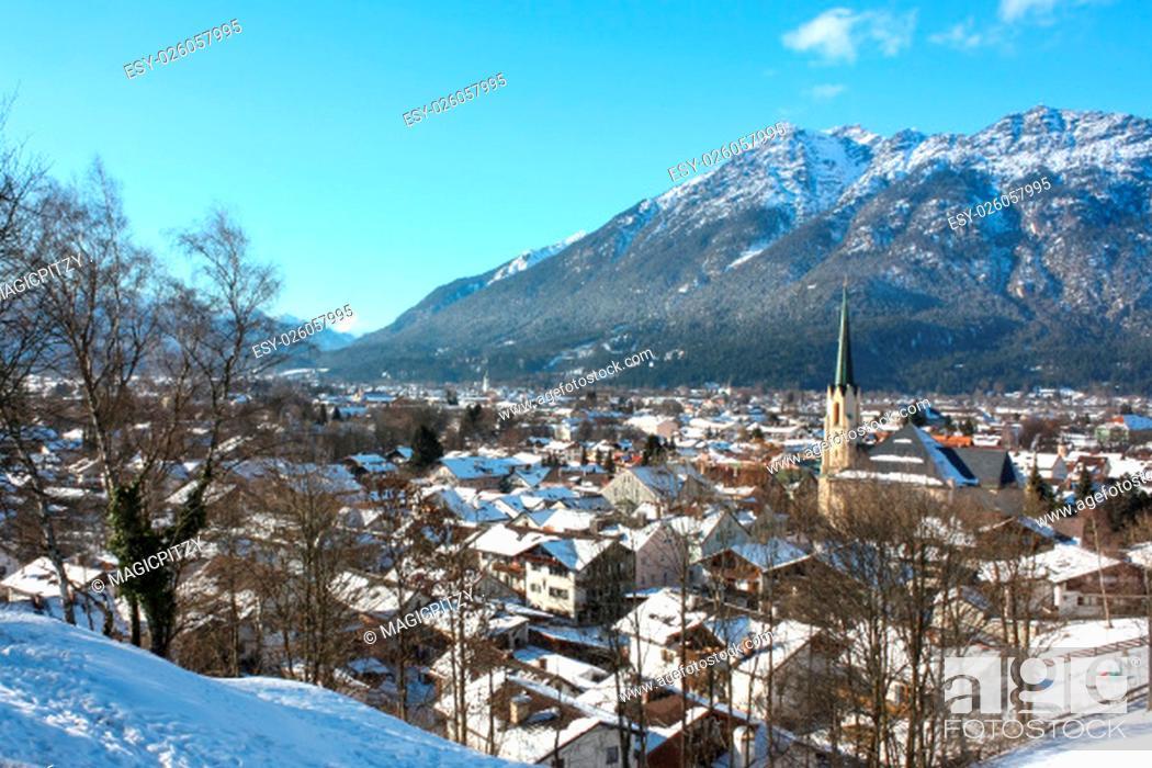 Stock Photo: garmisch-partenkirchen - partenkirchener townscape in winter with church and mountain views.