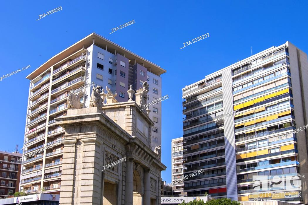 Stock Photo: Triumphal Arch in Valencia in front of modern architecture, Spain.