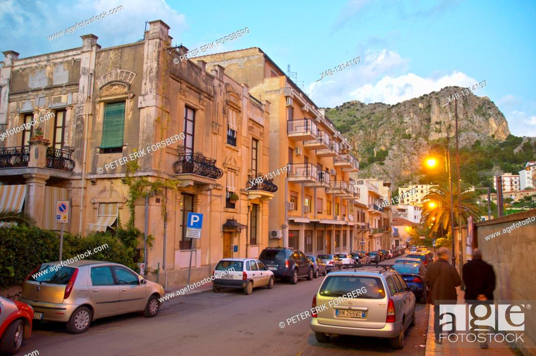 Stock Photo: Street scene at dusk with La Rocca mountain Cefalu town Sicilia Italy Europe.