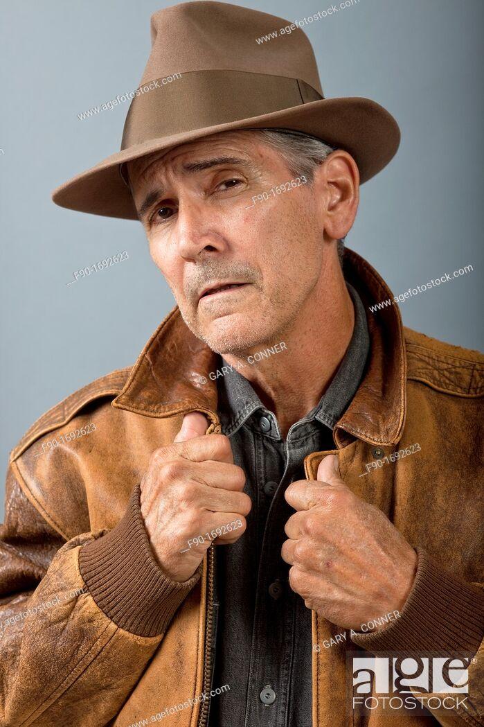 Stock Photo: Man in leather jacket-studio.