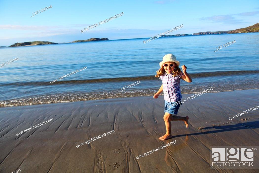 Stock Photo: girl running on sandy beach, Sutherland, Scotland.