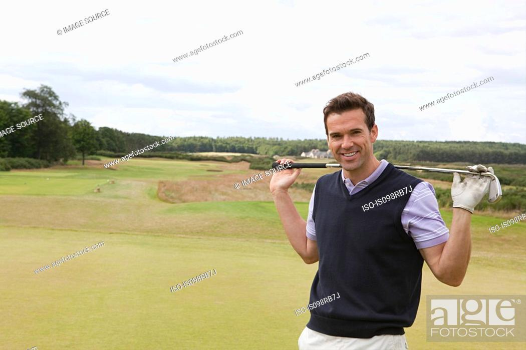 Stock Photo: Male golfer on the fairway.