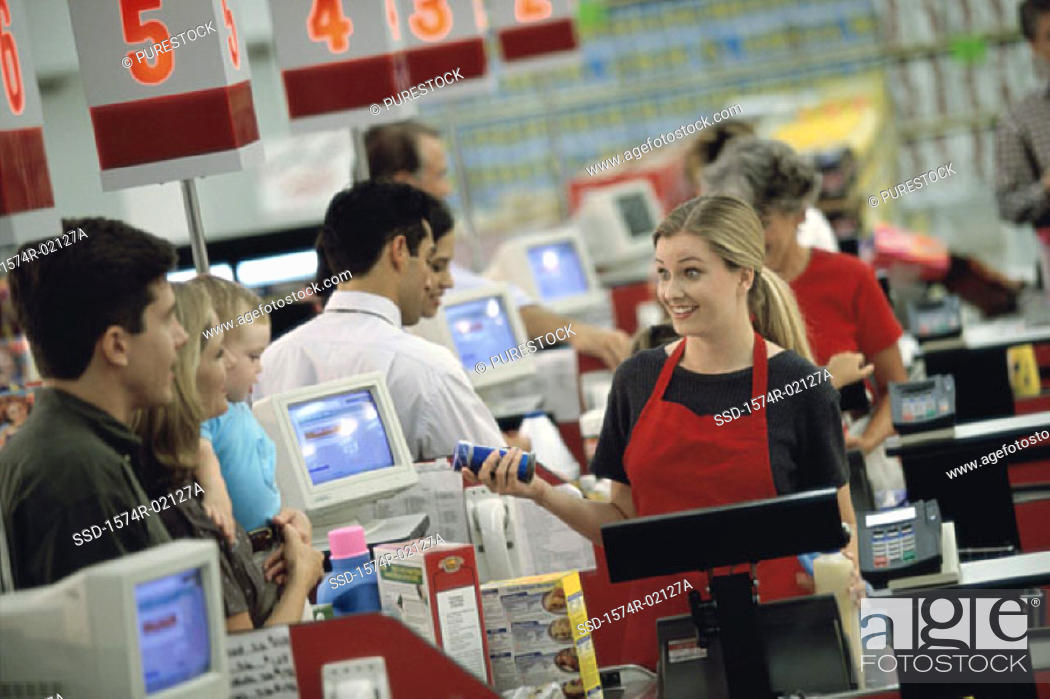 Stock Photo: Customers standing at a checkout counter in a supermarket.
