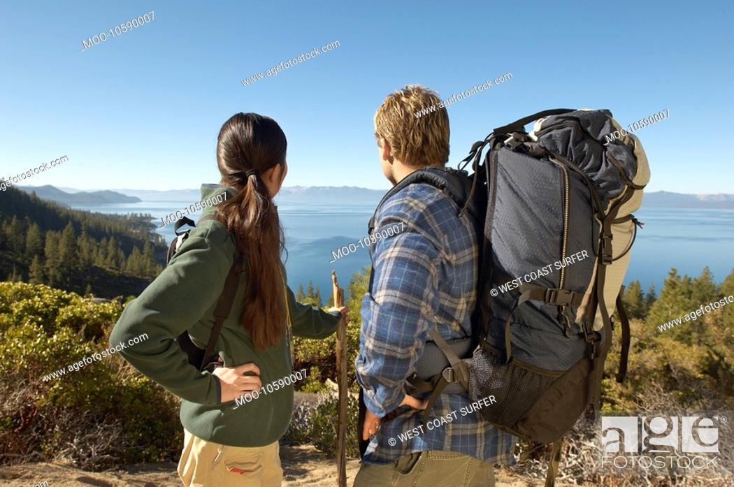 Stock Photo: Couple hiking at coast.