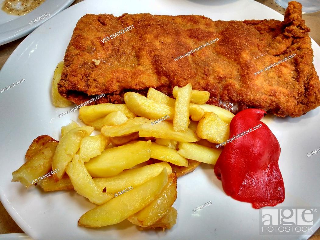 Stock Photo: Delicious crunchy breaded steak with jam and cheese, typical from Asturias, Spain.
