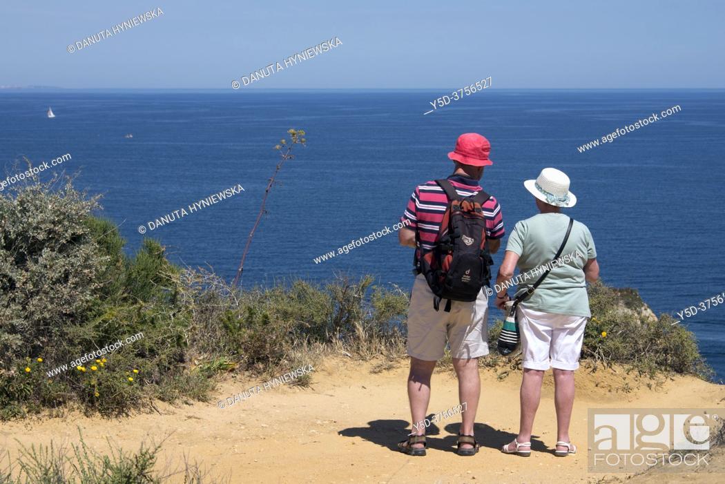 Imagen: Atlantic coast in Lagos seen from Ponta da Piedade, mature couple admiring view from Ponta da Piedade, Lagos, Algarve, Portugal, Europe.