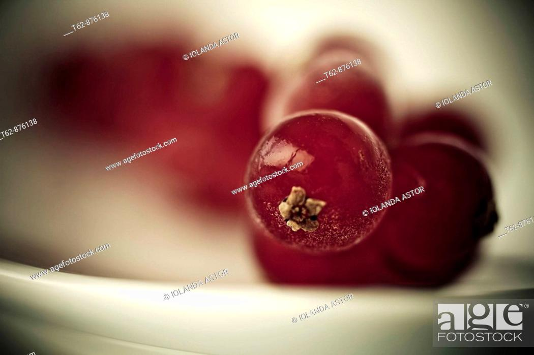 Stock Photo: Red fruit on a plate.