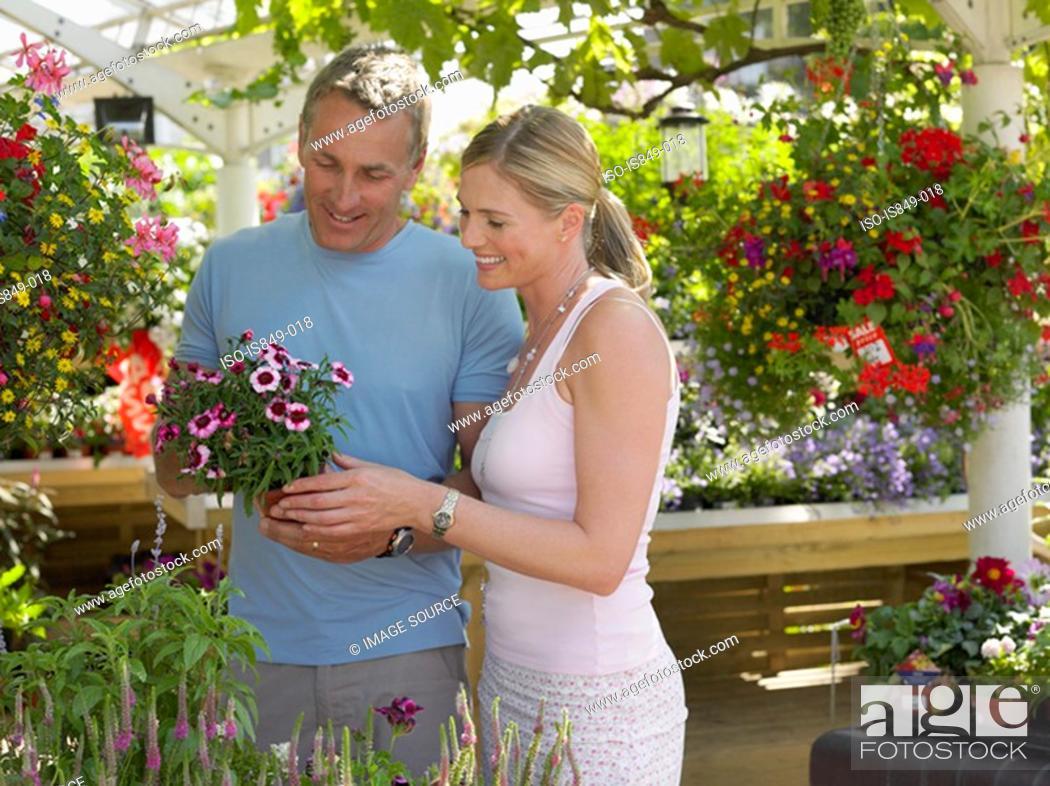 Stock Photo: Couple in a garden centre.