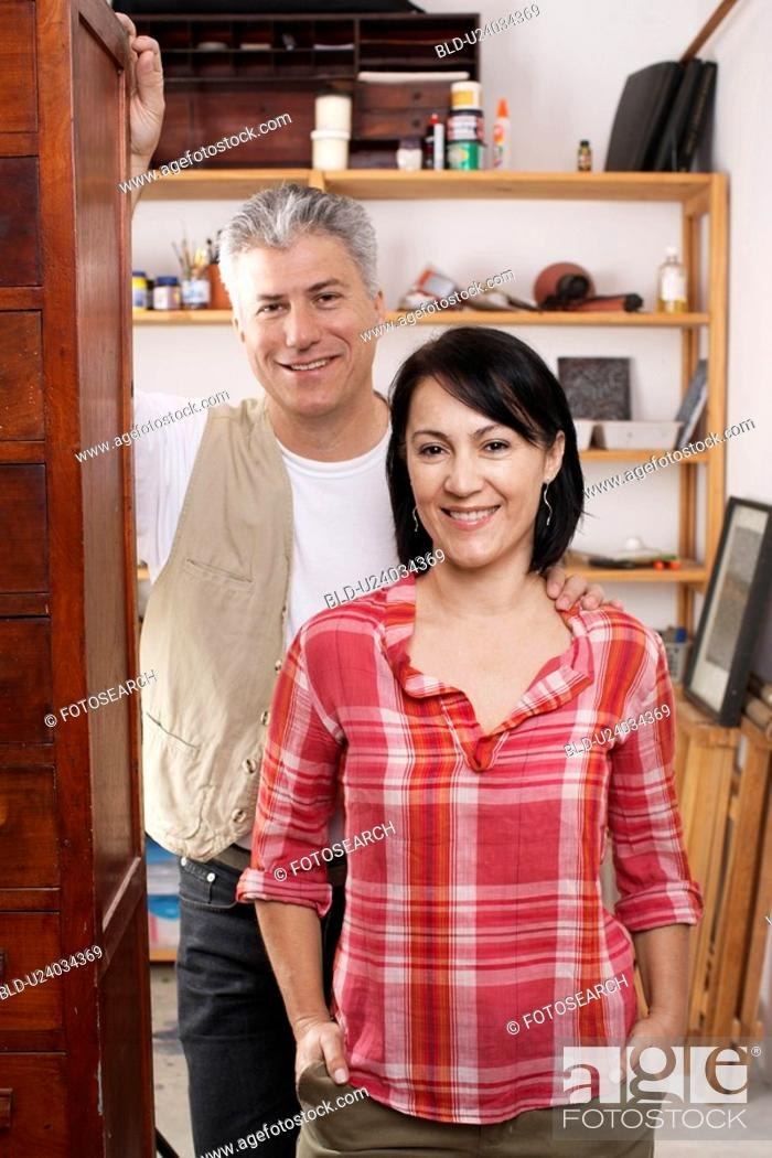Stock Photo: Portrait of mature couple at doorway.