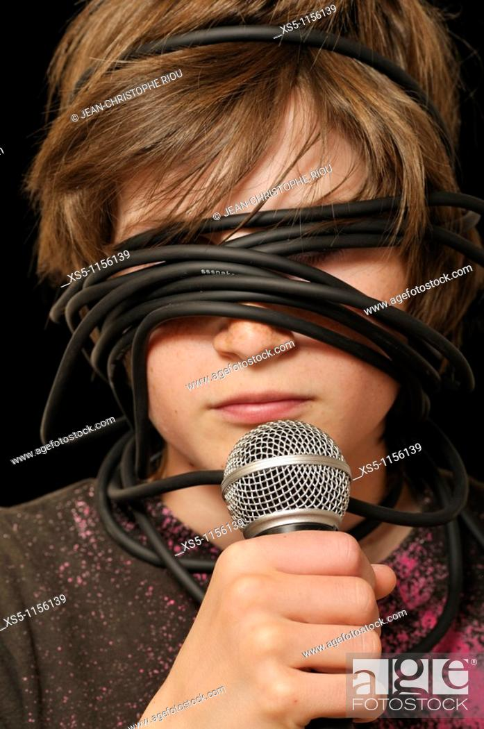 Stock Photo: boy sightless with a microphone.
