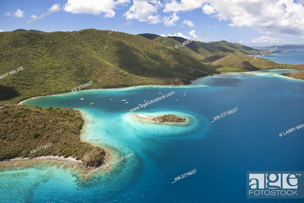 Stock Photo: Aerial view of Waterlemon Cay with the North Shore of St. John in the distance.