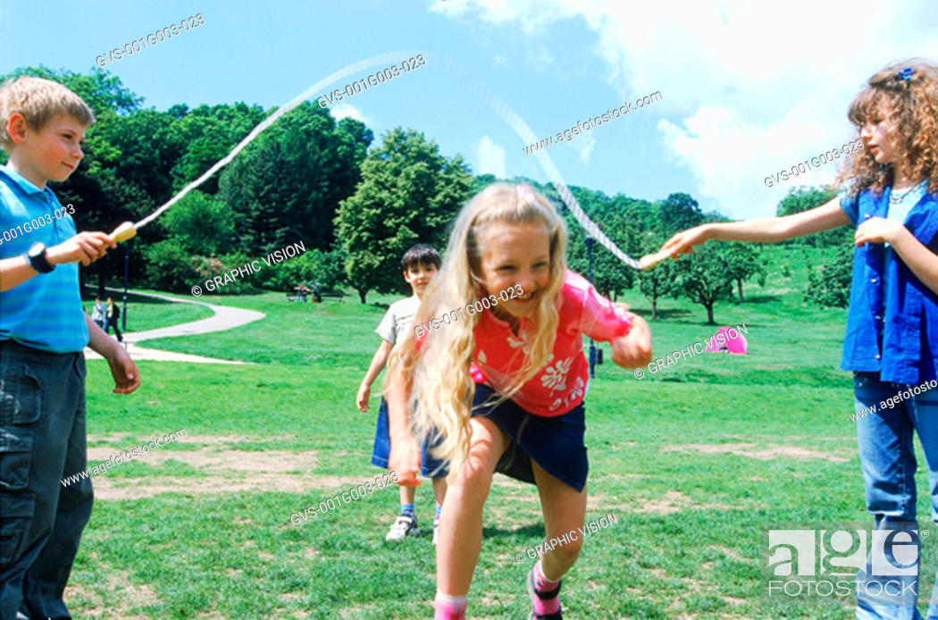 Stock Photo: Young children playing with skipping rope.