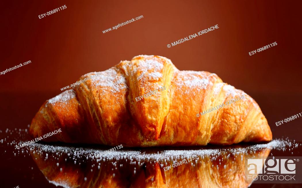 Stock Photo: Fresh and tasty croissant with butter.