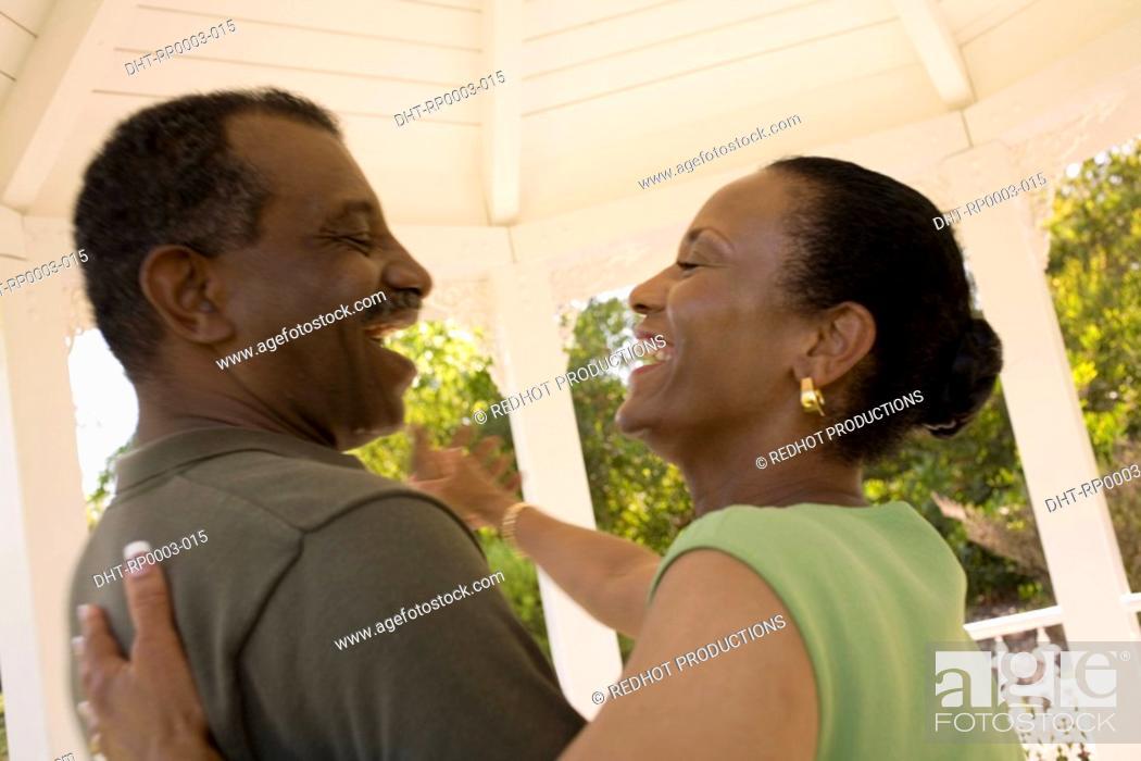 Stock Photo: A couple in a gazebo dancing.