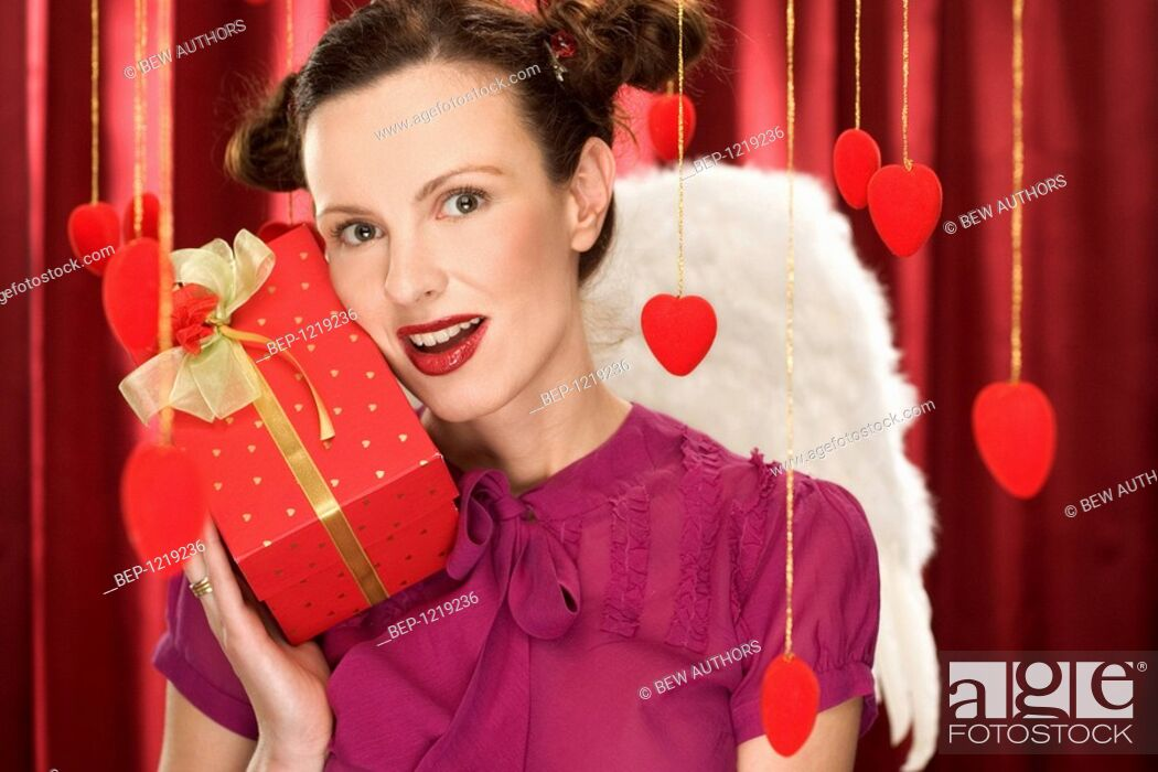 Stock Photo: Woman holding gift.