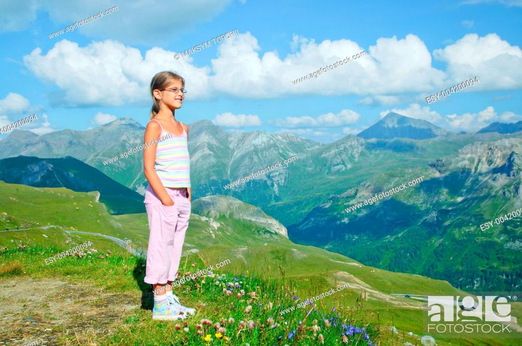 Stock Photo: Girl Looking At The Mountains.