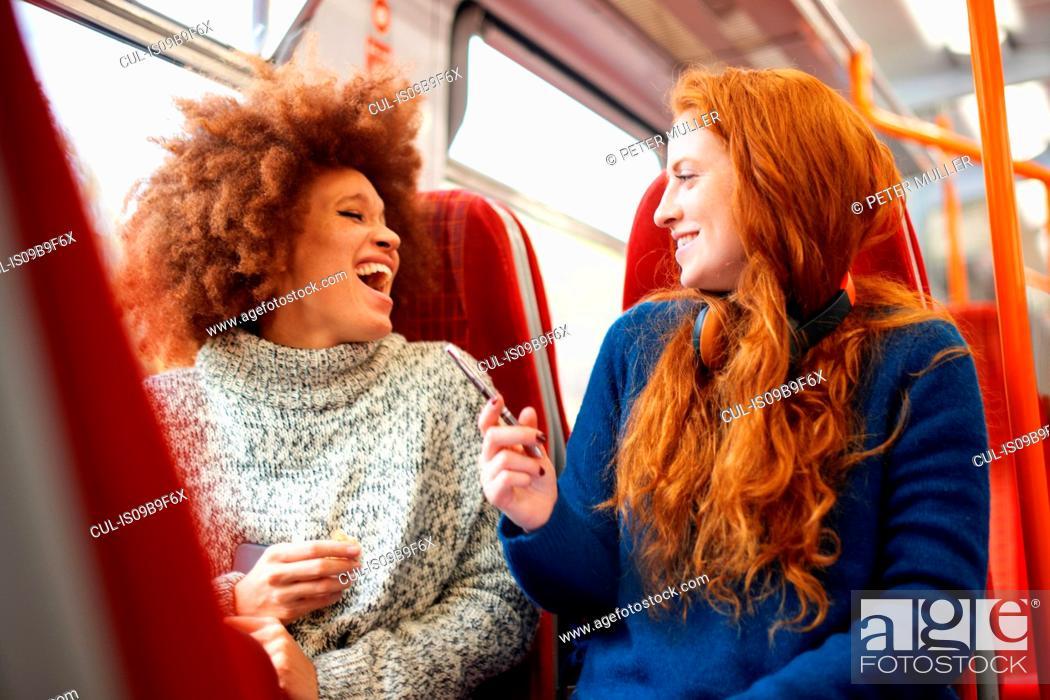 Stock Photo: Friends on train, London.