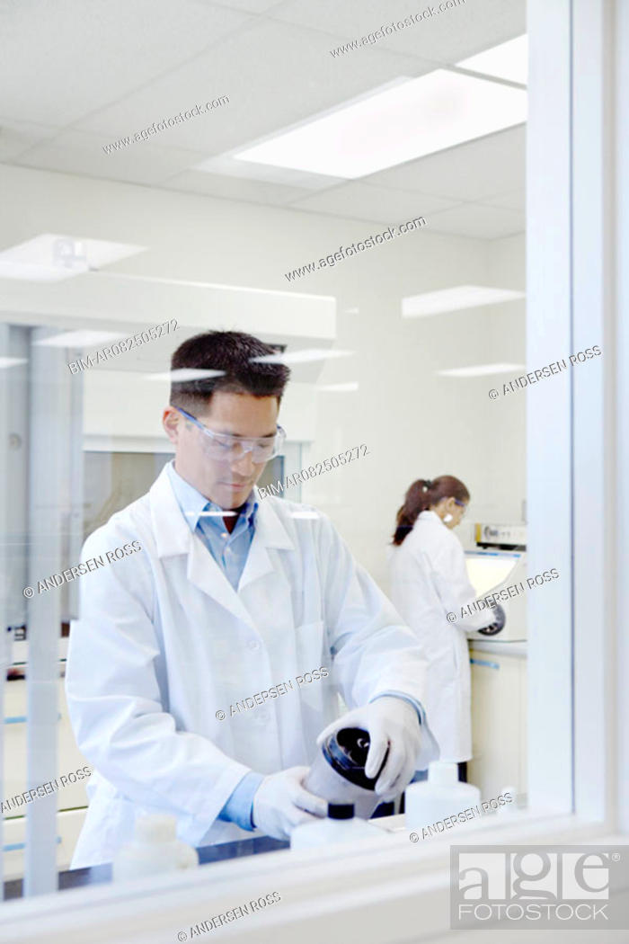 Stock Photo: Technicians in lab working.