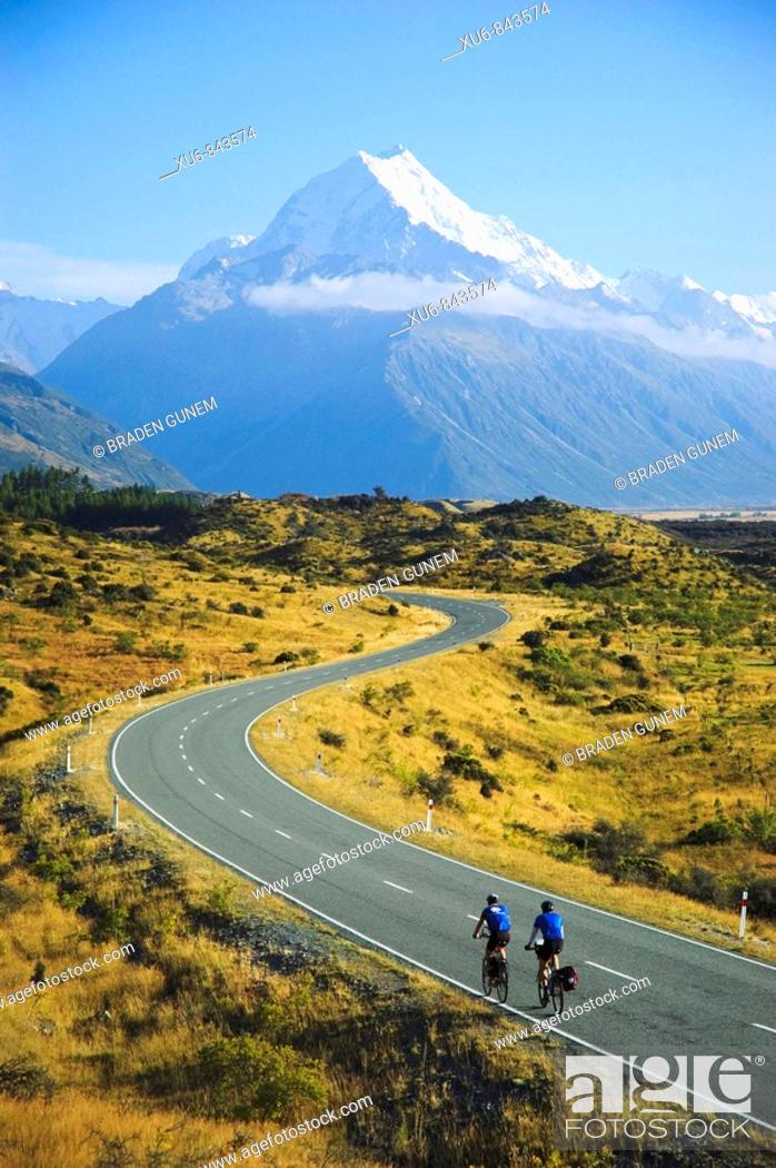 Stock Photo: Cyclist riding to Mt Cook New Zealand.