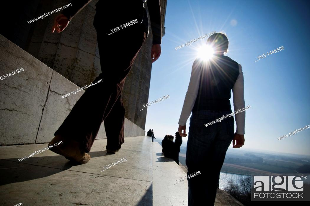 Stock Photo: Two women walking along steps of Walhalla temple with Danube river in background, Regensburg, Germany.