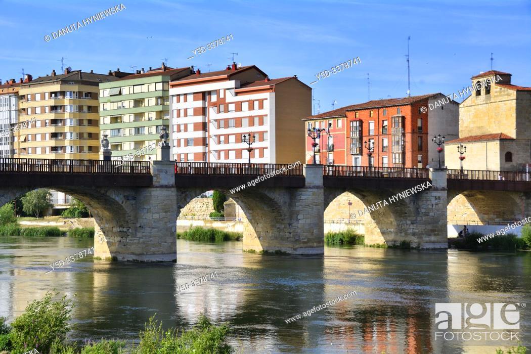 Stock Photo: Miranda de Ebro view across Ebro river, new apartment buildings, Iglesia Espiritu Santo and Puente de Carlos III - Carlos III bridge, Burgos province.