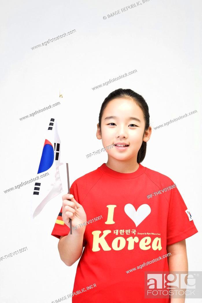 Stock Photo: girl holing Korean flag, Taegeukgi.