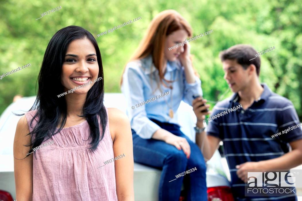 Stock Photo: Teenagers with car.