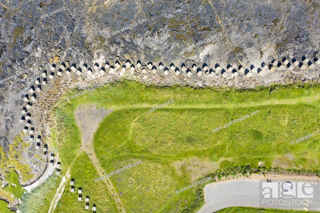 Stock Photo: Aerial view of Second World War era anti-tank blocks on shore at Gosford Sands at Longiddry in East Lothian, Scotland, UK.