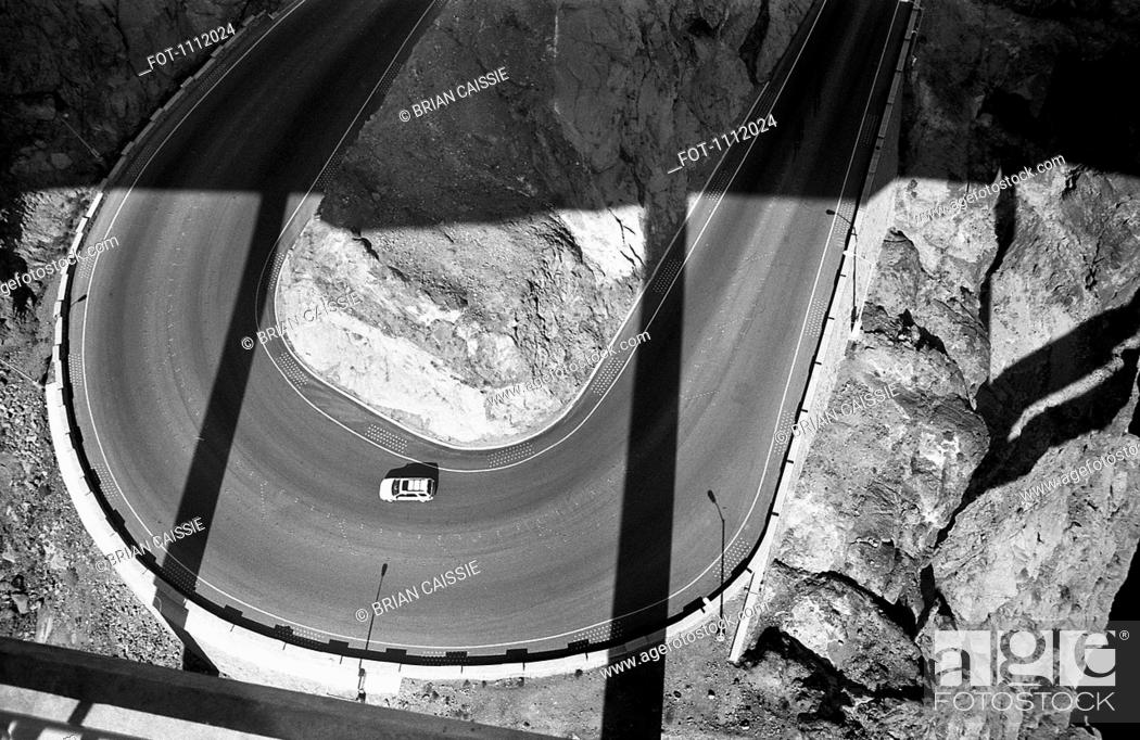 Stock Photo: A car on a two lane highway, high angle view.