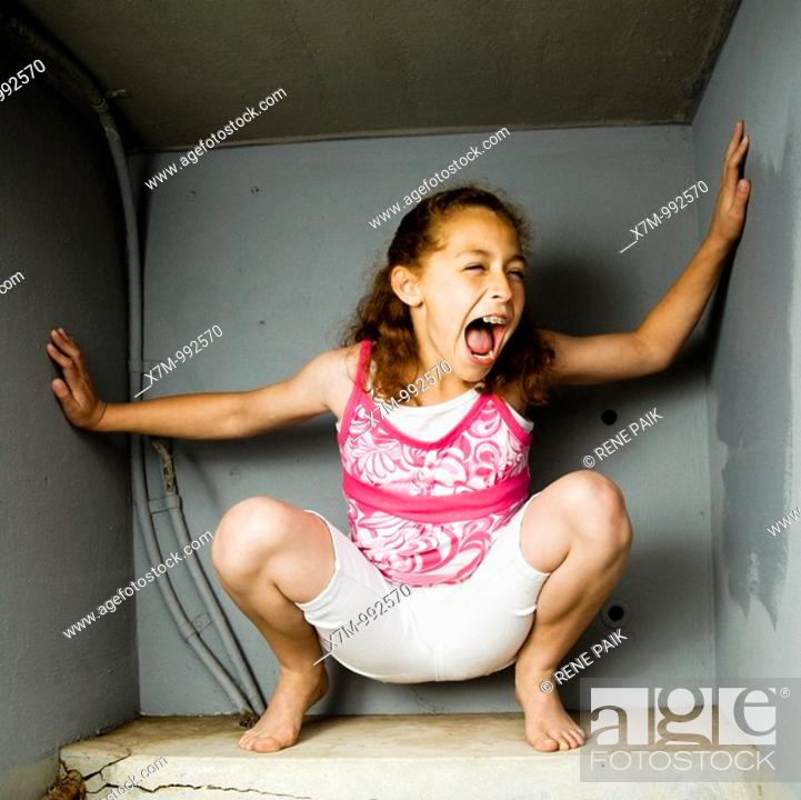 Stock Photo: A mixed race girl Mexican & caucasian trapped in a box.