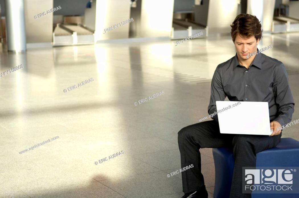 Stock Photo: Businessman using a laptop.