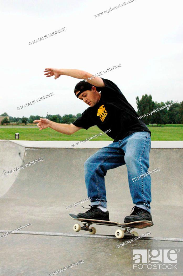 Stock Photo: Skateboarder skating on the rim.