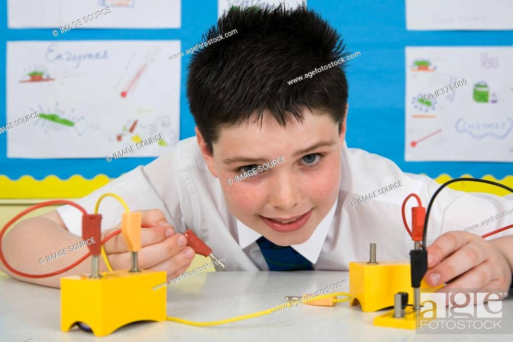 Stock Photo: Boy in science lesson.