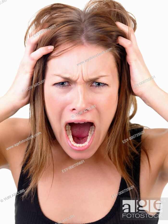 Stock Photo: Very frustrated and angry mad woman hands in her hair pulling Isolated on white background.