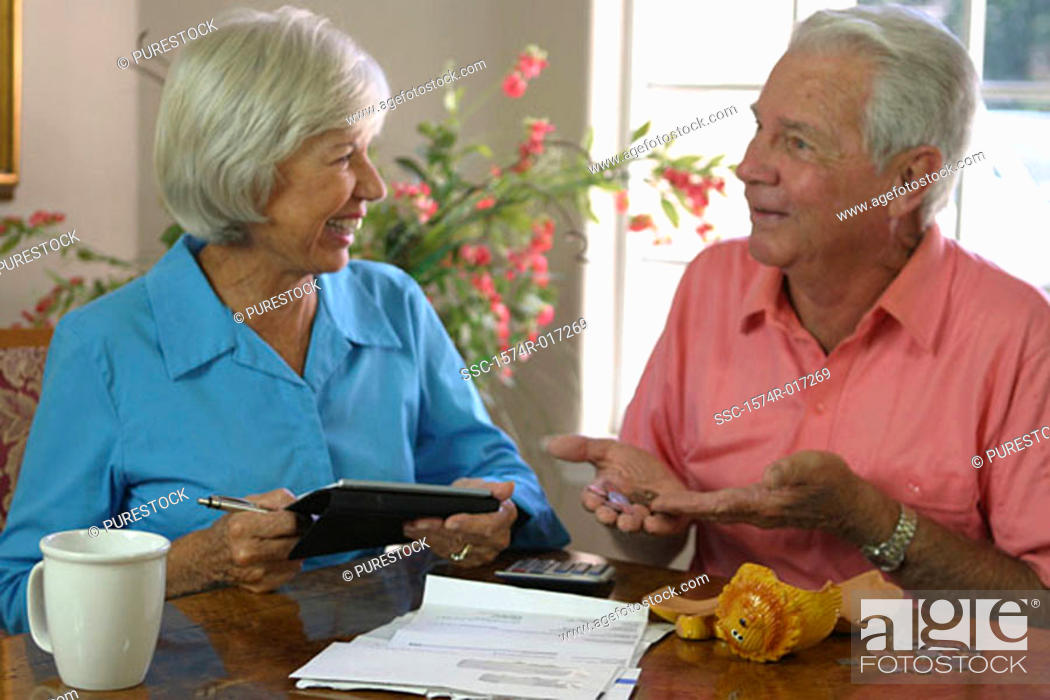 Stock Photo: Close-up of a senior couple looking at each other smiling.