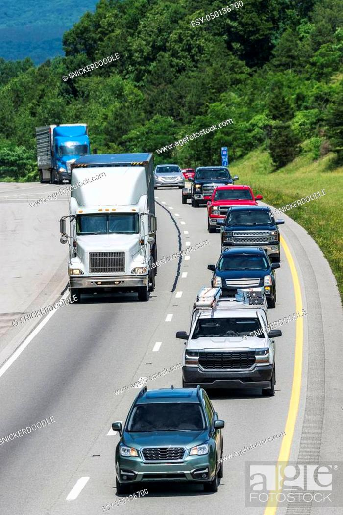 Stock Photo: A long line of mixed traffic travels I-40 in east Tennessee. Note: All logos and identifying marks have been removed from all vehicles.