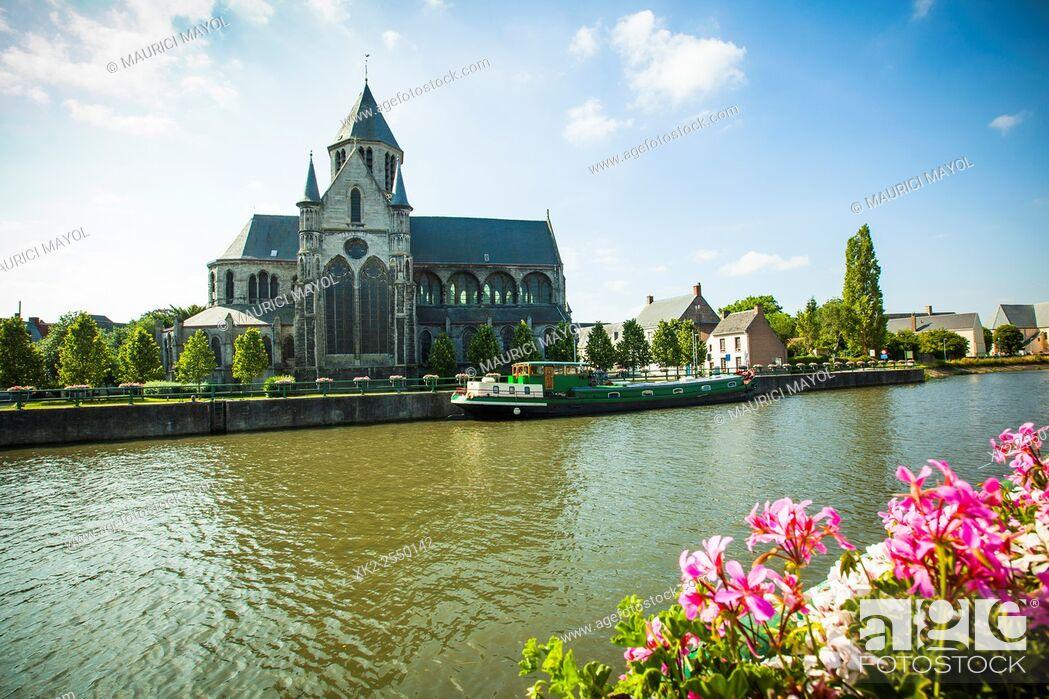 Stock Photo: Church next to the river Schelde, Oudenaarde.