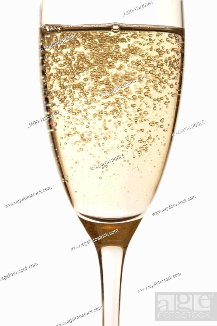 Stock Photo: Glass of Champagne close up in studio.
