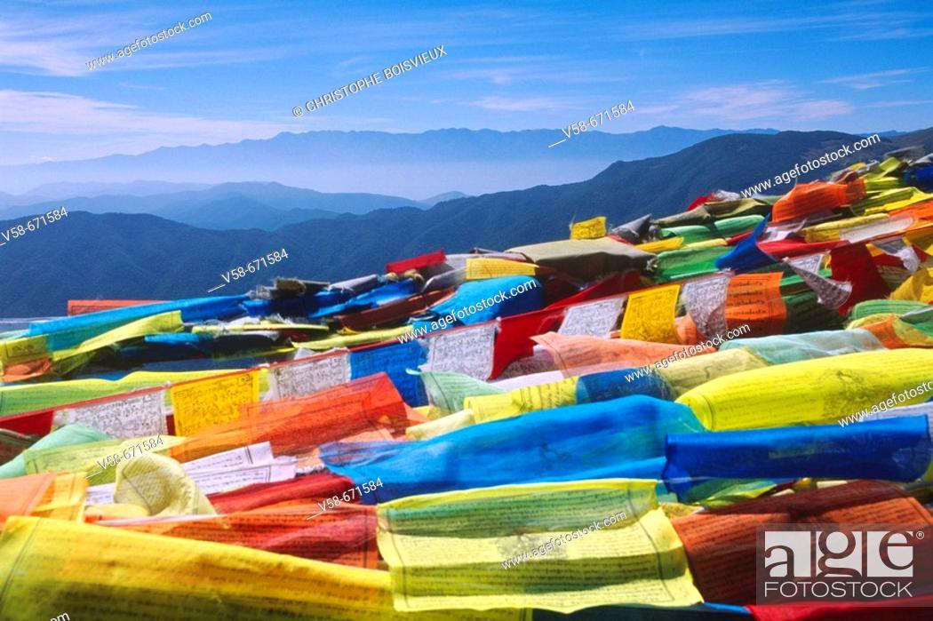 Stock Photo: Prayer flags on top of jizu shan mountain, yunnan, China.