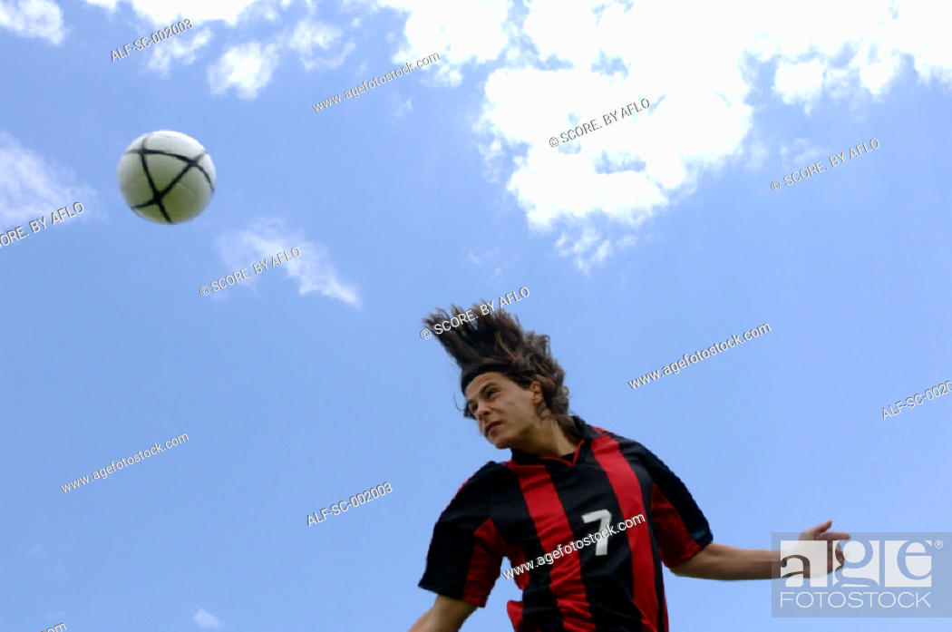 Stock Photo: Soccer player heading ball.