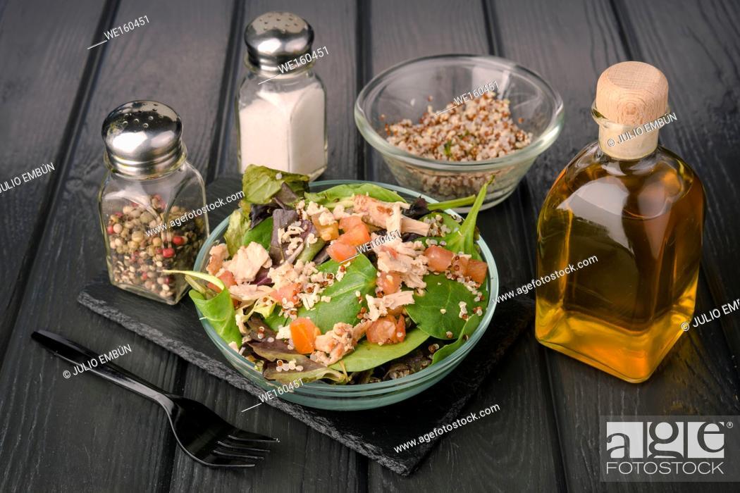 Photo de stock: salad on black wooden board.