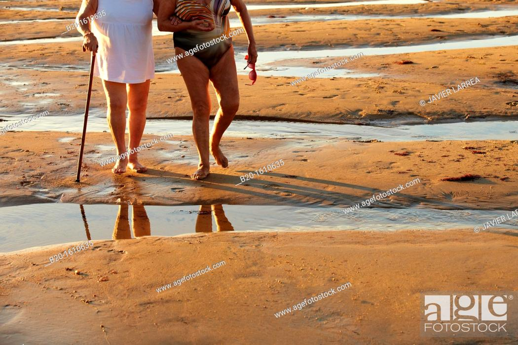 Stock Photo: Seniors walking, Zurriola Beach, Donostia, San Sebastian, Gipuzkoa, Basque Country, Spain.