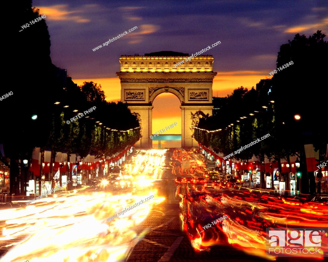 champs elysee and the arc de triomphe at night in paris stock photo