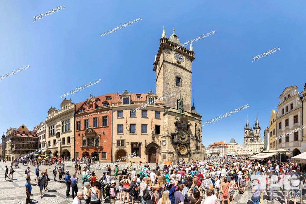 Stock Photo: Czech Republic, Prague, Crowds of tourists in front of the Astronomical clock at Old Town Hall with Tyn Cathedral in the background.