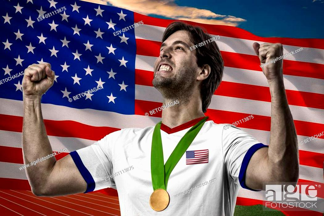Stock Photo: American Athlete Winning a golden medal in front of a american flag.
