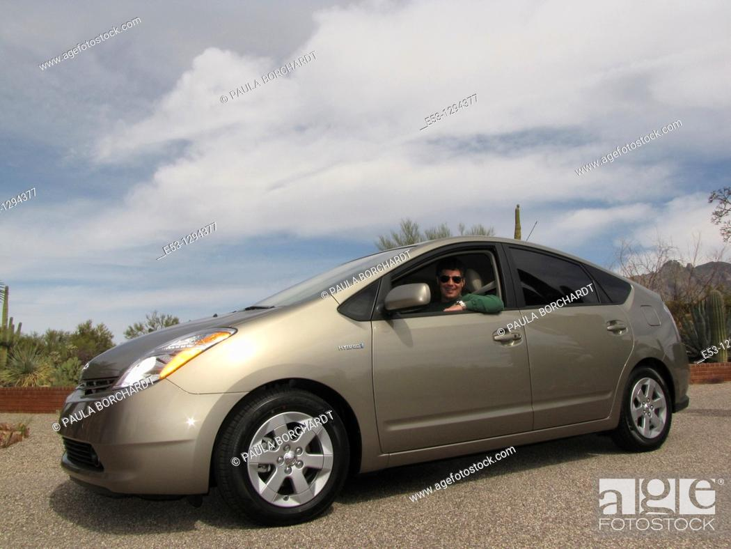 Stock Photo: Man, 40s MR100 in 2009 Toyota Prius PR006, Tucson, AZ, USA.