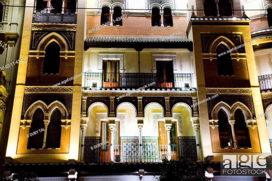 Stock Photo: Night photograph of the streets of Seville in Andalusia Spain.
