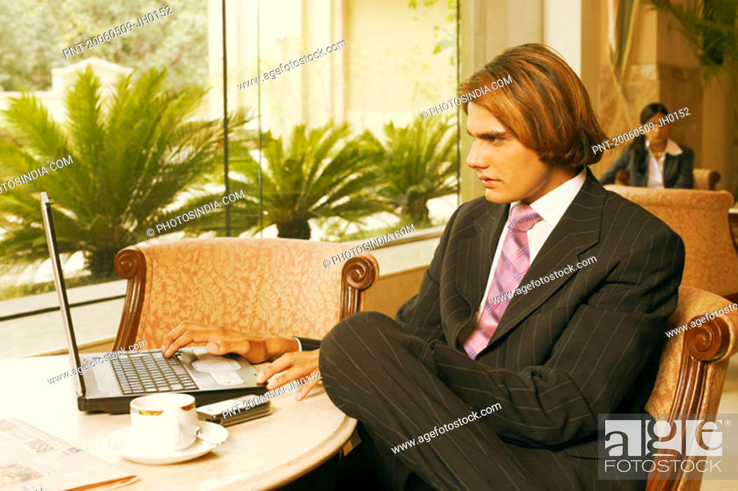 Stock Photo: Close-up of a businessman operating a laptop.