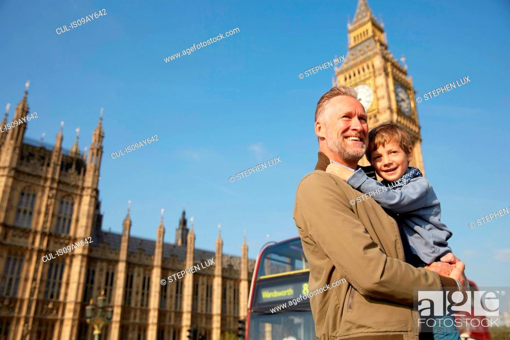 Stock Photo: Father carrying son in front of big ben.