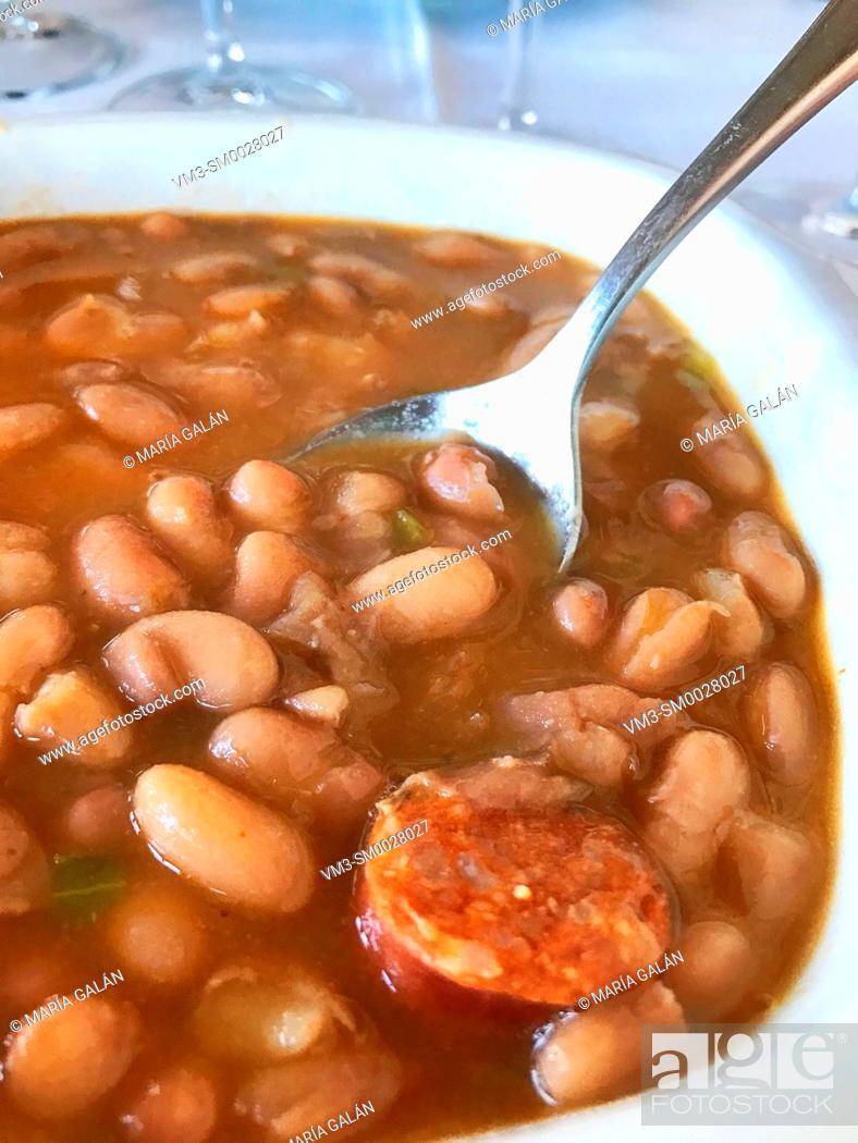 Stock Photo: Beans stew with chorizo. Spain.